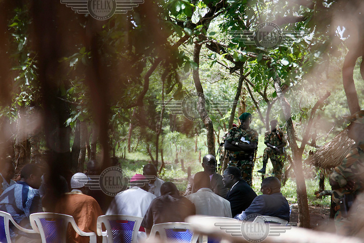 Vice President of Southern Sudan Riek Machar Teny (second from right, dark suit, glasses) during a meeting with elders, religious leaders and members of the Lord's Resistance Army (LRA). Beside Machar is James Obita (purple shirt), a key member of the LRA team negotiating a peace deal. For the last two decades Joseph Kony and the Lord's Resistance Army have been terrorising the northern provinces of Uganda, abducting over 20,000 children and forcing 1.6 million people to flee their homes.