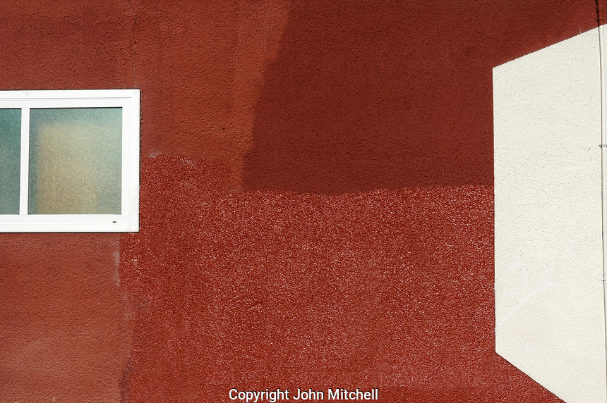 Red stucco wall and squares and rectangles designs