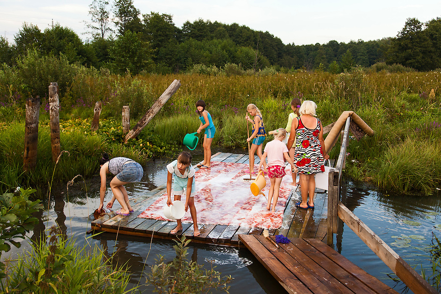 Novy Gorky, Ivanova Region, Russia, 05/08/2012..Children help wash carpets in a village river near Novy Gorky, some 200 miles east of Moscow.