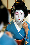 Geisha Norie prepares for work in Tokyo, Japan.