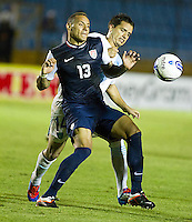 Jermaine Jones (13) tries to hold of Guatemala's (14) Luis Rodriguez as the United States played Guatemala at Estadio Mateo Flores in Guatemala City, Guatemala in a World Cup Qualifier on Tue. June 12, 2012.