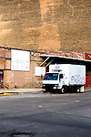 A small refrigerated truck sits waiting for it's next cargo on the side streets in Chicago's meat packing district.