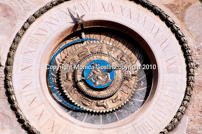 The clock on the clock tower in the Piazza Erbe in Mantua, Italy. The astrological clock in Piazza Erbe in Mantua, Italy.