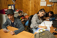 "Italy. Lazio region. Rome. A group of romanian teenagers sit inside "" A casa di Roro"" , which offers a place to meet and be together to romanian teenagers, all coming from immigrant family. Romanian immigration. Immigration is the act of foreigners passing or coming into a country for the purpose of permanent residence. 1.10.2011 © 2011 Didier Ruef"
