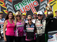 Oct 6, 2013; Mohnton, PA, USA; (right to left) NHRA funny car driver John Force celebrates with daughters Brittany Force , Courtney Force and wife Laurie Force after winning the Auto Plus Nationals at Maple Grove Raceway. Mandatory Credit: Mark J. Rebilas-