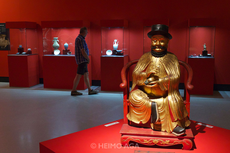 Linz, Austria. Schlossmuseum (Castle Museum).<br /> Marco Polo exposition &ldquo;Von Venedig nach China (From Venice to China)&rdquo;.<br /> Copy of the idol with effigy of Marco Polo, worshipped in the Temple of 500 Genii in Canton. Gilded wood, 19th century.