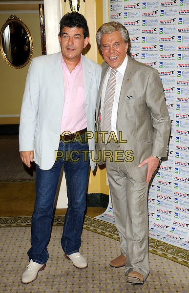 JOHN ALTMAN & LIONEL BLAIR .Attending Lionel Blair's 60th Year In Showbiz party, The Dorchester hotel, Park Lane, London, England, UK, .May 31st 2009..full length grey gray suit tie brown shoes loafers jeans pink shirt .CAP/CAN.©Can Nguyen/Capital Pictures