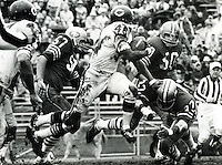 Chicago Bears Dick Gordon against the San Francisco 49ers, Frank Nunley, Ed Beard, and Jimmy Johnson.<br />(1967 photo by Ron Riesterer)