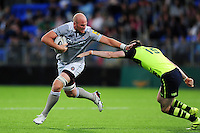 Matt Garvey of Bath Rugby takes on the Leinster defence. Matt Garvey of Bath Rugby takes on the Leinster defence. Pre-season friendly match, between Leinster Rugby and Bath Rugby on August 26, 2016 at Donnybrook Stadium in Dublin, Republic of Ireland. Photo by: Patrick Khachfe / Onside Images
