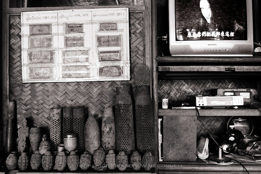 Grenades and various war scrap on display in a guesthouse in Phonsavan, Northern Laos. Xieng Knouang province is one of the most bombed areas in the world, being bombed on an almost daily basis at the height of the Secret War.
