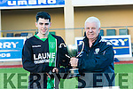 Fenit Samphires Captain Christopher Murphy is Presented with the Cup by John O'Regan  in the Munster Youth Cup Kerry Area Final Fenit Samphires V Listowel Celtic at Mounthawk Park on Saturday