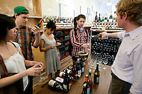 Customers taste wines at Chambers Street Wines in New York, NY, USA, 22 May 2009. The store specializes in naturally made wines from artisanal small producers and has received a Slow Food NYC Snail of Approval.