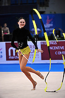 Alina Maksymenko of Ukraine performs cossack leap with hoop at 2010 Pesaro World Cup on August 28\, 2010 at Pesaro, Italy.  Photo by Tom Theobald.