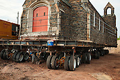 NCCU's historic, 234-ton, Holy Cross Catholic Church was on the move, slowly, across campus Friday. Unforeseen obstacles have halted the move; so for now, the 57-year-old church is parked in a driveway next to the student union. .