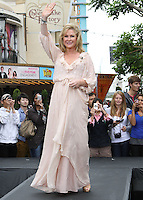 "Kathy Hilton.Gabriel Mann And Kathy And Paris Hilton Fashion Show On ""Extra"" Held at The Grove, West Hollywood, California, USA..May 2nd, 2012.full length white beige pink dress maxi hand arm in air waving .CAP/ADM/KB.©Kevan Brooks/AdMedia/Capital Pictures."
