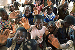 RImages MPHANDULA, MALAWI - AUGUST 21: Unidentified orphans during a pre-school class under a thatched roof on August 21, 2006 in Mphandula village, about 30 miles outside Lilongwe, Malawi. Mphandula is a poor village in Malawi, without electricity or clean water. Nobody owns a car or a mobile phone. Most people live on farming. About 7000 people reside in the village and the chief estimates that there are about five-hundred orphans. Many have been affected by HIV/Aids and many of the children are orphaned. A foundation started by Madonna has decided to build an orphan center in the village through Consol Homes, a Malawi based organization. Raising Malawi is investing about 3 million dollars in the project and Madonna is scheduled to visit the village in October 2006. Malawi is a small landlocked country in Southern Africa without any natural resources. Many people are affected by the Aids epidemic. Malawi is one of the poorest countries in the world and has about 1 million orphaned children. (Photo by Per-Anders Pettersson)