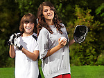 Smiling teenage sister and a younger brother practicing baseball, active summer outdoor lifestyle portrait.
