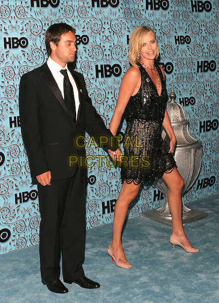 STUART TOWNSEND & CHARLIZE THERON.HBO's Post Emmy Party following the 57th Annual Primetime Emmy Awards held at the Pacific Design Center, West Hollywood, California. .September 18th, 2005.Photo Credit: Zach Lipp/AdMedia/Capital Pictures.Ref: ZL.full length celebrity couple boyfriend girlfriend holding hands black suit black dress sequins.www.capitalpictures.com.sales@capitalpictures.com.© Capital Pictures.
