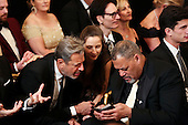 Actor Jeff Goldblum (L), his wife Emily Goldblum and actor Laurence Fishbone, wait for the beginning of an event for the 2016 Kennedy Center Honorees, in the East Room of the White House, December 4, 2016. The 2016 honorees are: Argentine pianist Martha Argerich; rock band the Eagles; screen and stage actor Al Pacino; gospel and blues singer Mavis Staples; and musician James Taylor.<br /> Credit: Aude Guerrucci / Pool via CNP