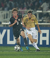 Alex Shinsky controls the ball ahead of Kevin (19). Spain defeated the U.S. Under-17 Men National Team  2-1 at Sani Abacha Stadium in Kano, Nigeria on October 26, 2009.