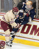 Teddy Doherty (BC - 4), Andy Ryan (ND - 6) - The Boston College Eagles defeated the visiting University of Notre Dame Fighting Irish 4-2 to tie their Hockey East quarterfinal matchup at one game each on Saturday, March 15, 2014, at Kelley Rink in Conte Forum in Chestnut Hill, Massachusetts.