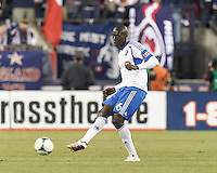 Montreal Impact defender Hassoun Camara (6) passes the ball.  In a Major League Soccer (MLS) match, Montreal Impact (white/blue) defeated the New England Revolution (dark blue), 4-2, at Gillette Stadium on September 8, 2013.