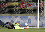 03 November 2010: Maryland's Yewande Balogun makes a save. The Maryland Terrapins defeated the Duke Blue Devils 1-0 in an ACC Women's Soccer Tournament quarterfinal game at Koka Booth Stadium at WakeMed Soccer Park in Cary, NC.