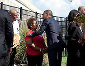 United States President Barack Obama greets a family member of the 9-11 attacks during a remembrance ceremony at the Pentagon in Washington, DC, on Sunday, September 11, 2011. .Credit: Joshua Roberts / Pool via CNP