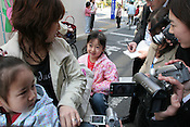 6 year old Sae, in pink, (surname withheld), with her mother Mitsue and young sister , outside the Nova school where Sae was taught by murdered UK girl Lindsay Ann Hawker, being interviewed by Japanese press, in Koiwa, Tokyo, Japan, on Wednesday, Mar. 28, 2007.