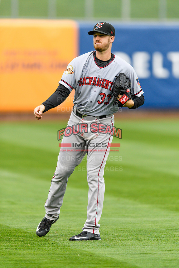 Sacramento River Cats starting pitcher Chris Stratton (33) warms up in the outfield before the game against the Salt Lake Bees in Pacific Coast League action at Smith's Ballpark on April 11, 2017 in Salt Lake City, Utah. The River Cats defeated the Bees 8-7. (Stephen Smith/Four Seam Images)