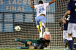 28 October 2014: Georgia Southern's Jack Falle (below) makes a save on North Carolina's Zach Wright (29). The University of North Carolina Tar Heels hosted the Georgia Southern University Eagles at Fetzer Field in Chapel Hill, NC in a 2014 NCAA Division I Men's Soccer match. North Carolina won the game 6-2.