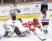 Taylor Holze (BU - 24) trips over Molly Schaus (BC - 30) while celebrating Wakefield's goal. - The visiting Boston University Terriers defeated the Boston College Eagles 1-0 on Sunday, November 21, 2010, at Conte Forum in Chestnut Hill, Massachusetts.