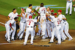 21 June 2011: Washington Nationals catcher Wilson Ramos comes home to score and be mobbed by his teammates after hitting a walk-off 3-run homer in the bottom of the 9th inning to win the game against the Seattle Mariners at Nationals Park in Washington, District of Columbia. The Nationals rallied from a 5-1 deficit, scoring 5 runs in the bottom of the 9th, to defeat the Mariners 6-5 in inter-league play. Mandatory Credit: Ed Wolfstein Photo