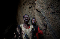 April 28, 2012 - Tabania, Nuba Mountains, South Kordofan, Sudan: Nuba women take cover from possible bombardments by Sudan's Army Forces airplane in some caves near Buram village...Since the 6th of June 2011, the Sudan's Army Forces (SAF) initiated, under direct orders from President Bashir, an attack campaign against civil areas throughout the South Kordofan's province. Hundreds have been killed and many more injured...Local residents, of Nuba origin, have since lived in fear and the majority moved from their homes to caves in the nearby mountains. Others chose to find refuge in South Sudan, driven by the lack of food cause by the agriculture production halt due to the constant bombardments of rural areas. (Paulo Nunes dos Santos/Polaris)