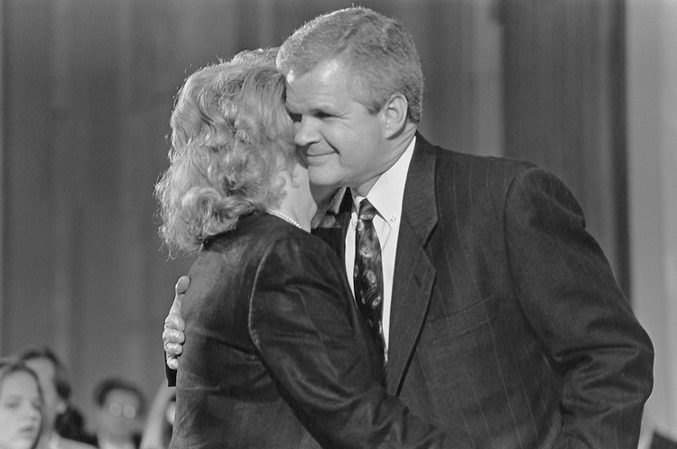 Woody Jenkins hugs his wife, Diane, before testifying at Senate Rules Committee. April 16, 1997 (Photo by Laura Patterson/CQ Roll Call)
