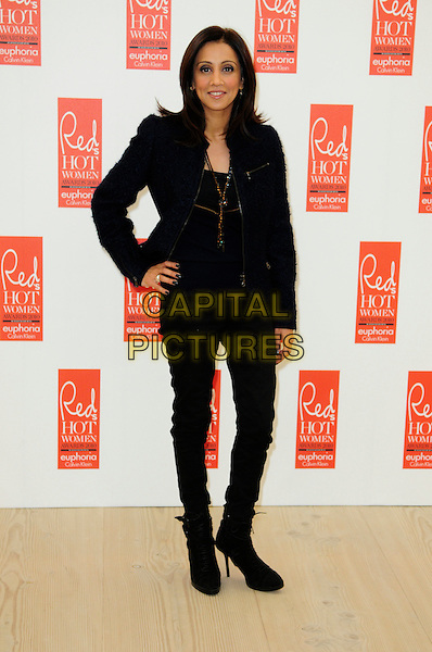 RIZ LATEEF .attends Red magazine's 'Red Hot Women Awards' at the Saatchi Gallery, London, England, UK, .November 30th 2010..full length black hand on hip jacket trousers knee high boots .CAP/CAS.©Bob Cass/Capital Pictures.