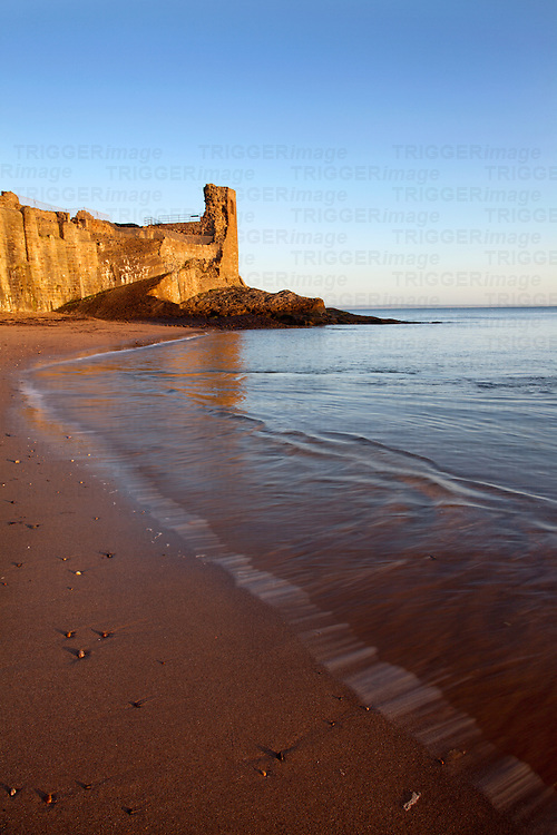 St Andrews Castle and Castle Sands at Sunrise St Andrews Fife Scotland