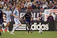 New England Revolution forward Kheli Dube (11) passes the ball as Colorado Rapids midfielder Jeff Larentowicz (4) closes. The Colorado Rapids defeated the New England Revolution, 2-1, at Gillette Stadium on April 24, 2010.