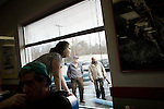 January 24, 2008. Laurens, SC.. Presidential candidate and former US senator, John Edwards campaigned across the western part of South Carolina today in an effort to shore up support before Saturday's primary election.. A anxious supporter waits at the window for the candidate to arrive.