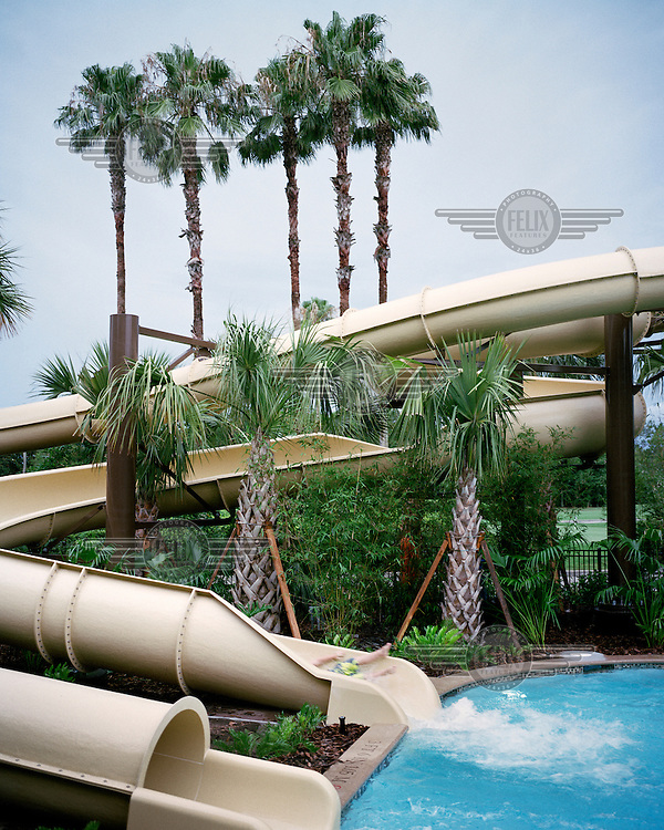 A boy rides on a water slide at the Marriott Hotel in Orlando, Florida.
