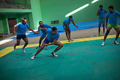A raider 3rd from left) aggresively tries to make a point while the defendant team-members try to stay away during the kabbadi training sessions as part of the training at a month long camp for the Indian national Kabbadi team in Sport Authority of India Sports Complex in Bisankhedi, outskirts of Bhopal, Madhya Pradesh, India.