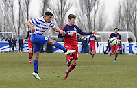 Reece Grego-Cox of QPR shoots under pressure from Greg Cochrane of Chicago Fire