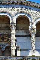 Close up of the Arcades and and columns of St Michele of the 13th century Romanesque facade of the San Michele in Foro,  a Roman Catholic basilica church in Lucca, Tunscany, Italy