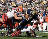 University of Pittsburgh Running Back LeSean McCoy dives forward for extra yardage as Syracuse Linebacker Jake Flaherty #45 and Defensive Back Nick Chestnut #27 converge to make the tackle.  The Pitt Panthers went on to defeat the Syracuse Orange 20-17 on November 03, 2007 at Heinz Field, Pittsburgh, Pennsylvania.