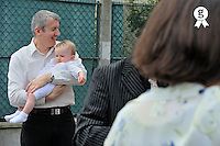 Father with son (8 months) at baptism ceremony  (Licence this image exclusively with Getty: http://www.gettyimages.com/detail/84430570 )