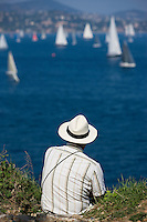 28SEP09 Les Voiles De St Tropez 2009..A spectator watches the racing from the top of the Citadel..