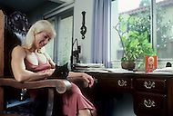 Los Angeles. April, 1981. Claudia Wilbourn, body building star, relaxing at home.