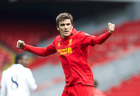 LIVERPOOL, ENGLAND - Easter Monday, April 1, 2013: Liverpool's Adam Morgan celebrates scoring the first goal against Tottenham Hotspur during the Under 21 FA Premier League match at Anfield. (Pic by David Rawcliffe/Propaganda)