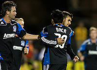 Chris Wondolowski of Earthquakes celebrates with Rafael Baca of Earthquakes after Wondolowski scored a goal during the game against the WhiteCaps at Buck Shaw Stadium in Santa Clara, California on July 20th, 2011.  Earthquakes and WhiteCaps are tied 2-2 at the end of the game.