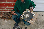 Lonnie Holley creates art from found objects. He holds a piece he created outside a warehouse that stores his artwork in Atlanta, Georgia, December 12, 2012. He found a softball, a baseball, and some other items.